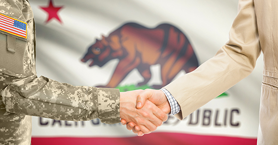 USA military man in uniform and civil man in suit shaking hands with certain USA state flag on background - California