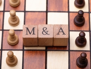 Wooden Blocks With Mergers And Acquisitions Text On Chess Board