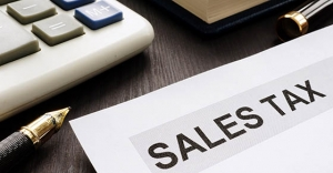 Sales tax. Papers on the office table.