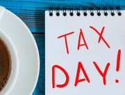 The inscription Tax Day on the note like Notification of the need to file tax returns, tax form